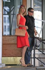 TAYLOR SWIFT in Red Dress Leaves Her Apartment in New York