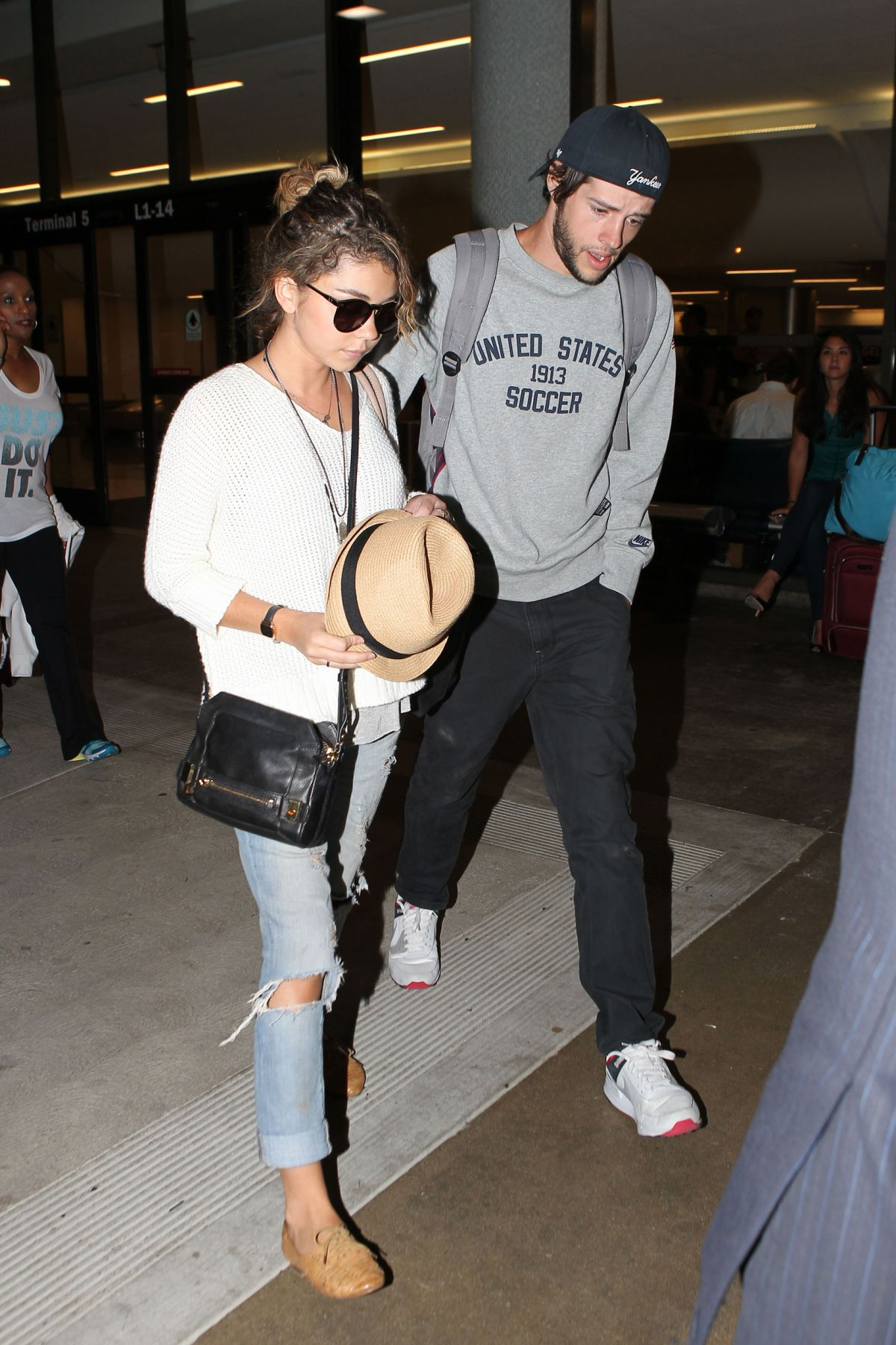SARAH HYLAND at LAX Airport in Los Angeles