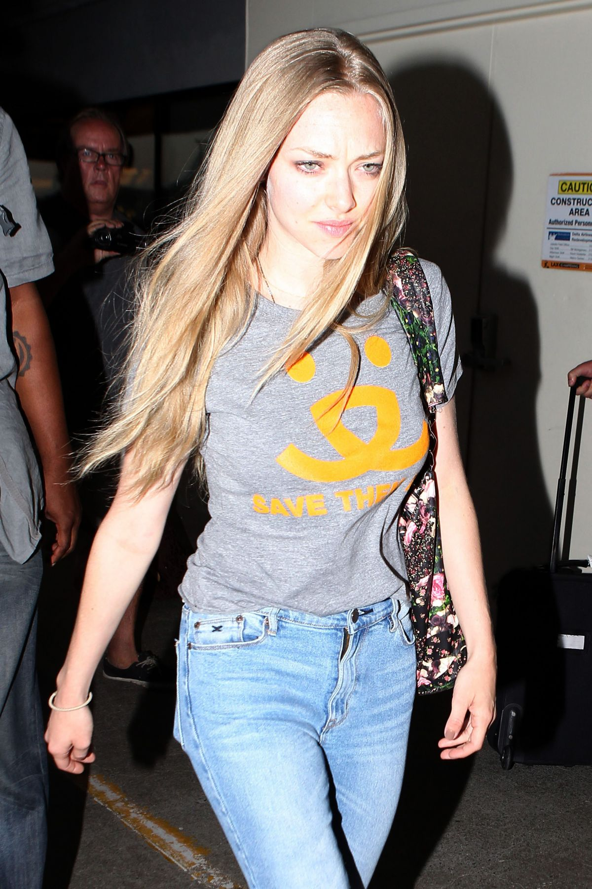 AMANDA SEYFRIED in Jeans at LAX Airport in Los Angeles