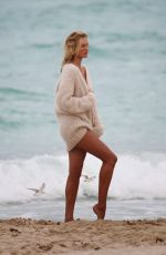 CANDICE SWANEPOEL at a Photoshoot at a Beach
