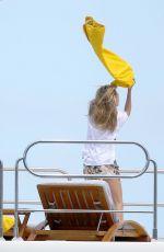 CARA DELEVINGNE in Bikini Celebrates Selena Gomez