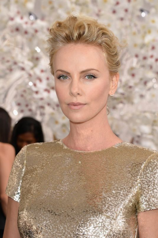 CHARLIZE THERON at Christian Dior Fashion Show in Paris