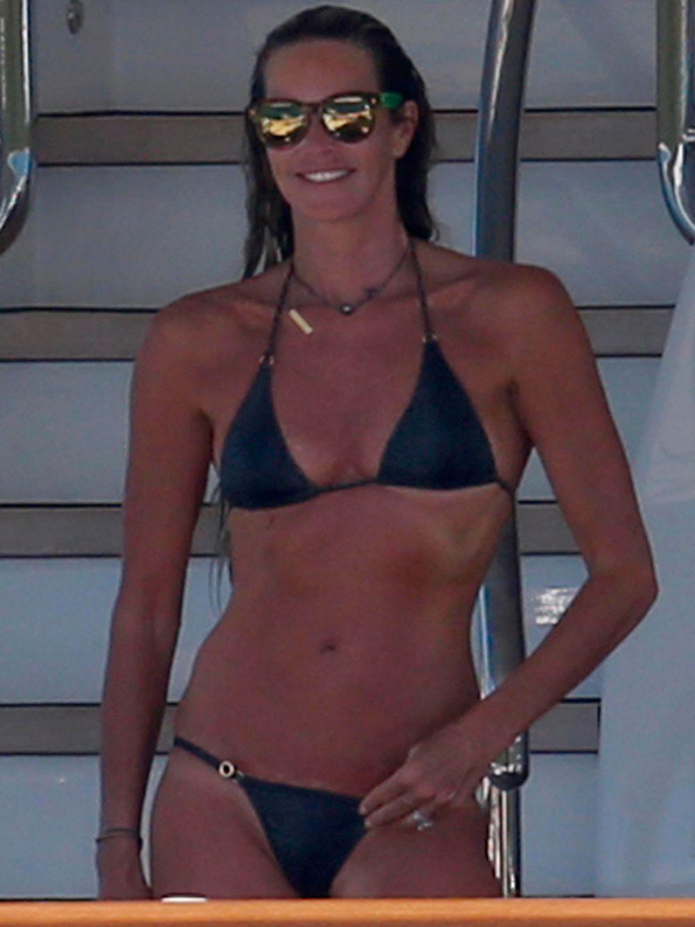 ELLE MACPHERSON in Bikini at a Yacht in Sardinia