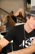 KAT GRAHAM at Warner Bros Signing Booth at Comic-con