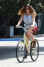 KELLY BROOK in Shorts Rides a Bike Out in Venice Beach
