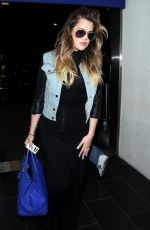 KHLOE KARDASHIAN Arrives at LAX AIrport in Los Angeles