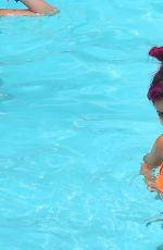 LILY ALLEN in Bikini at a Hotel Pool in New York