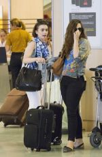 LILY COLLINS at Airport in Ibiza