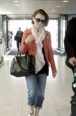 LILY COLLINS at Heathrow Airport in London
