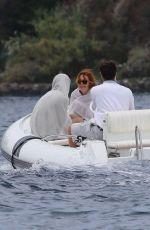 LINDSAY LOHAN in Bikini in a Boat at Ischia