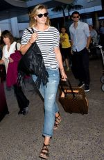 MARIA SHARAPOVA in Jeans Arrives at LAX Airport