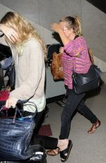MARY KATE and ASHLEY OLSEN at LAX Airport in Los Angeles