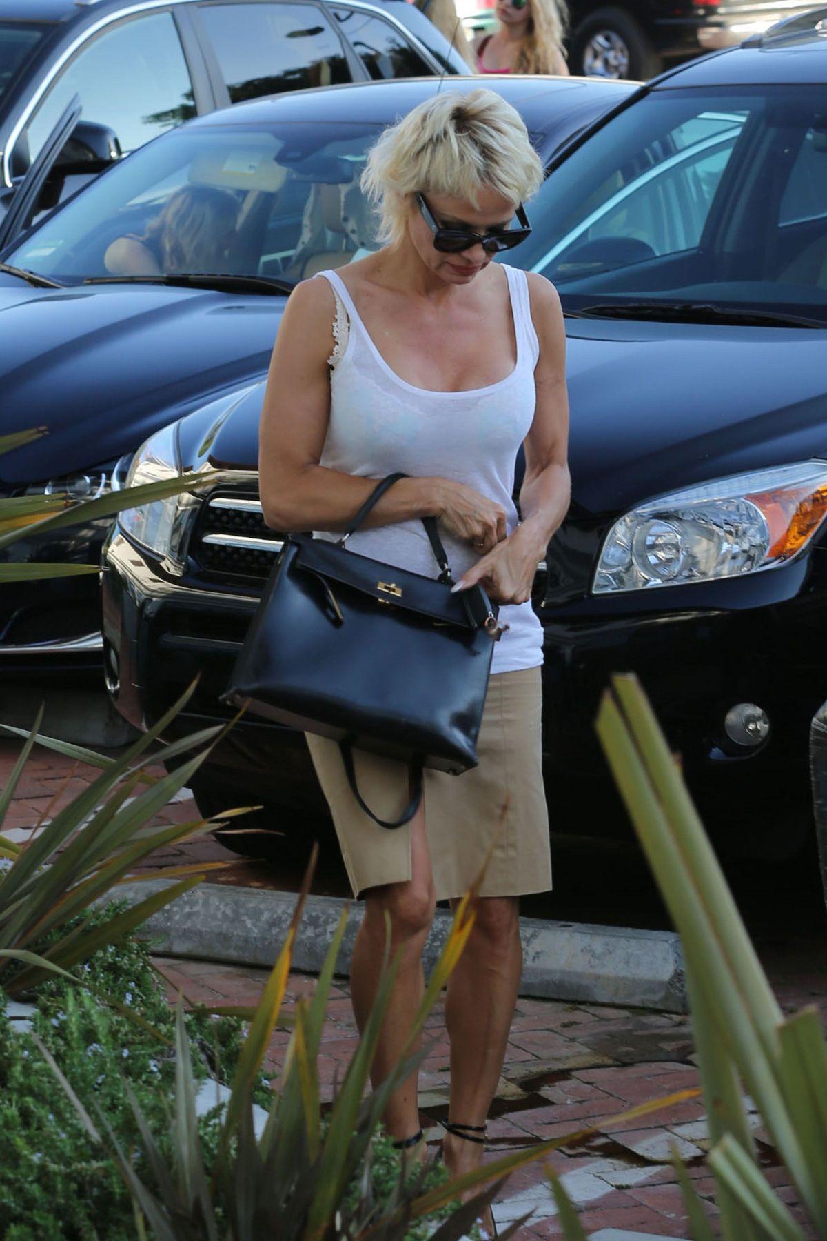 PAMELA ANDERSON Arrives at Malibu Country Mart