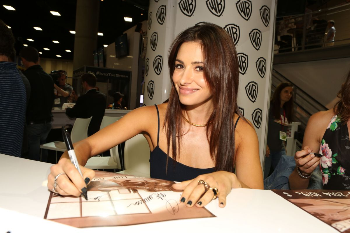 SARAH SHAHI at Warner Bros Signing Booth at Comic-con
