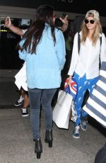 SELENA GOMEZ and CARA DELEVINGNE Arrves at LAX Airport