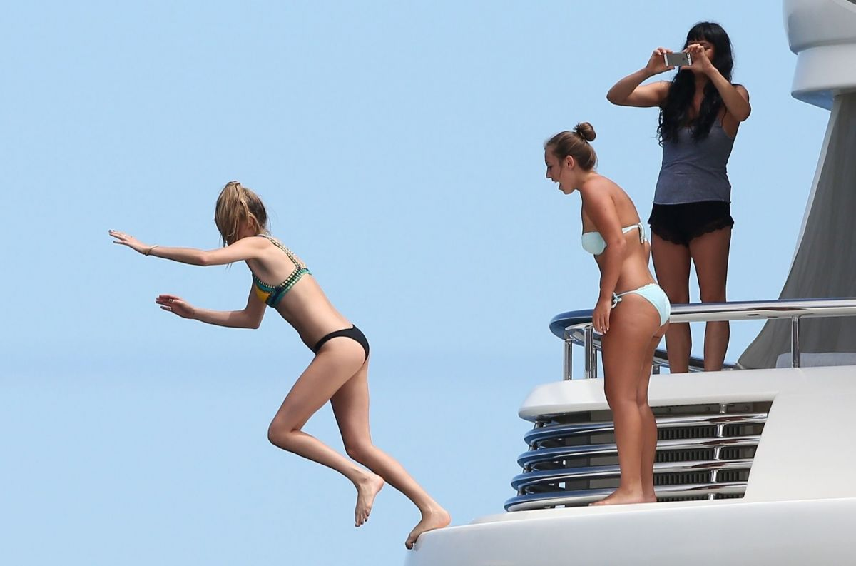 SELENA GOMEZ and CARA DELEVINGNE at a Yacht in St. Tropez