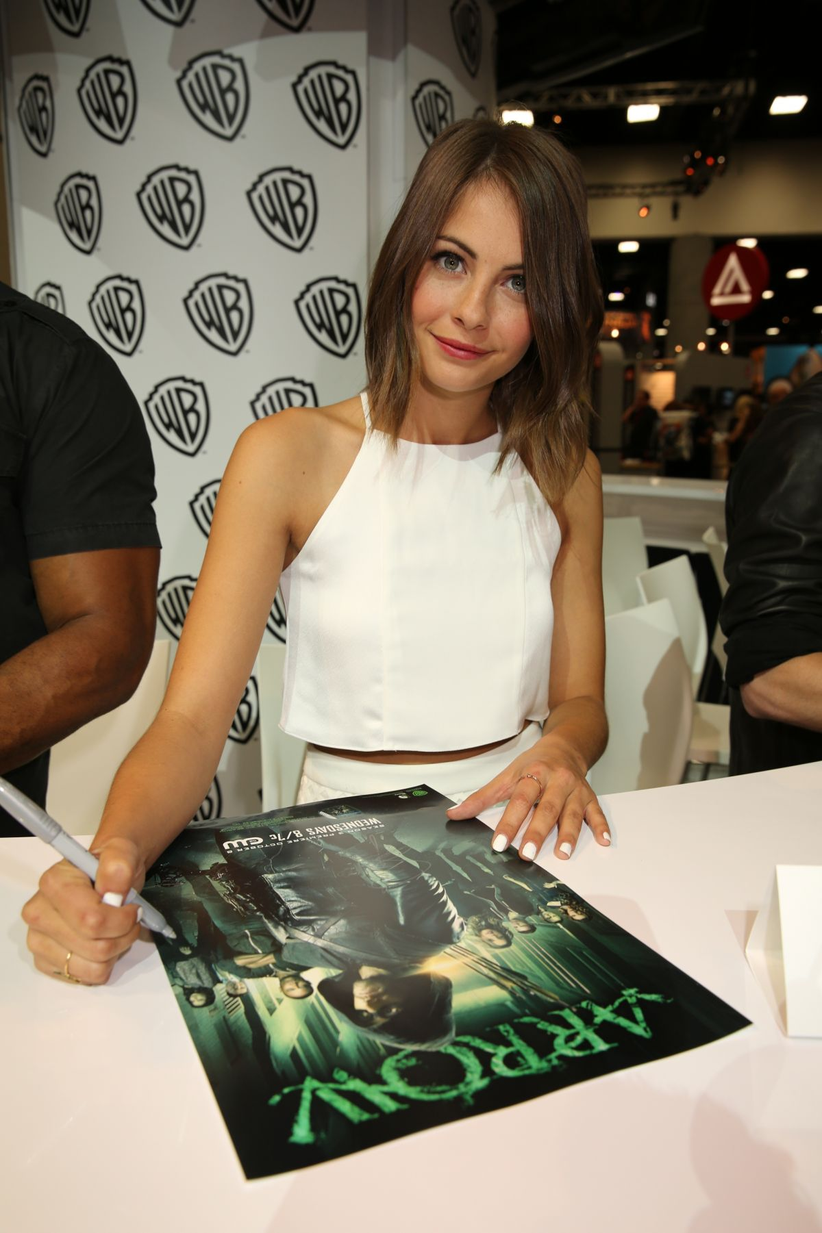 WILLA HOLLAND at Warner Bros Signing Booth at Comic-con