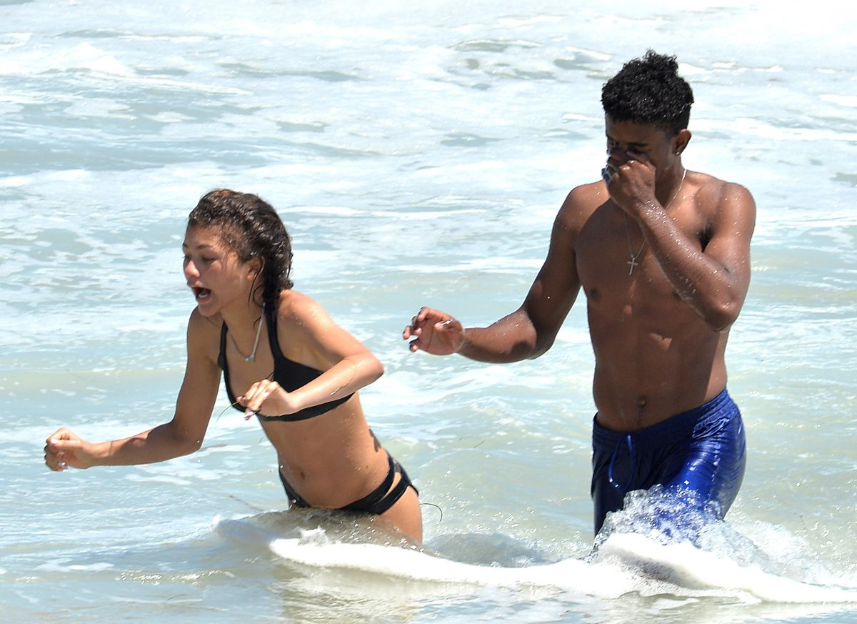 ZENDAYA COLEMAN in Covered Bikini on the Beach in MalibuZendaya Coleman At The Beach