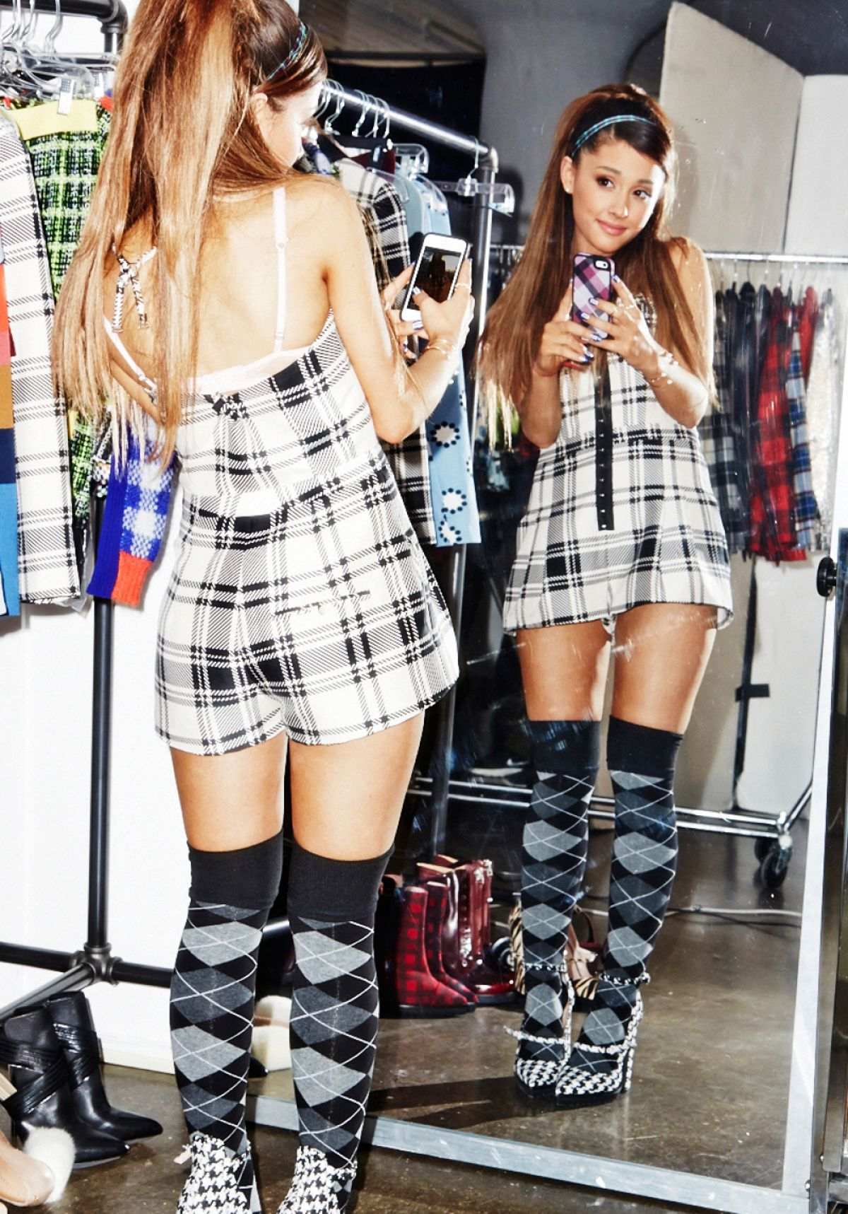 Ariana Grande flaunts her toned midriff and slim thighs in