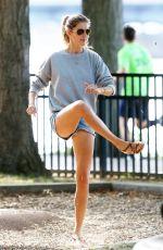 GISELE BUNDCHEN Playing Soccer at a Park in Boston