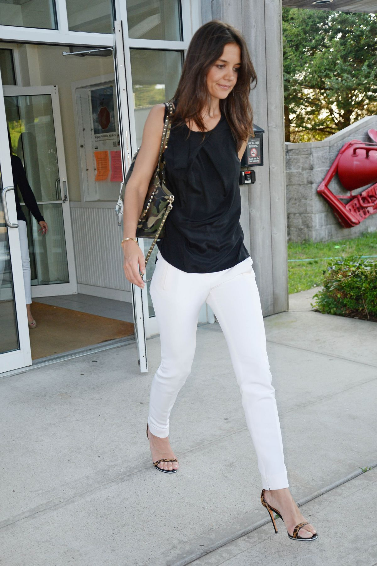 KATIE HOLMES at East Hampton Airport in New York