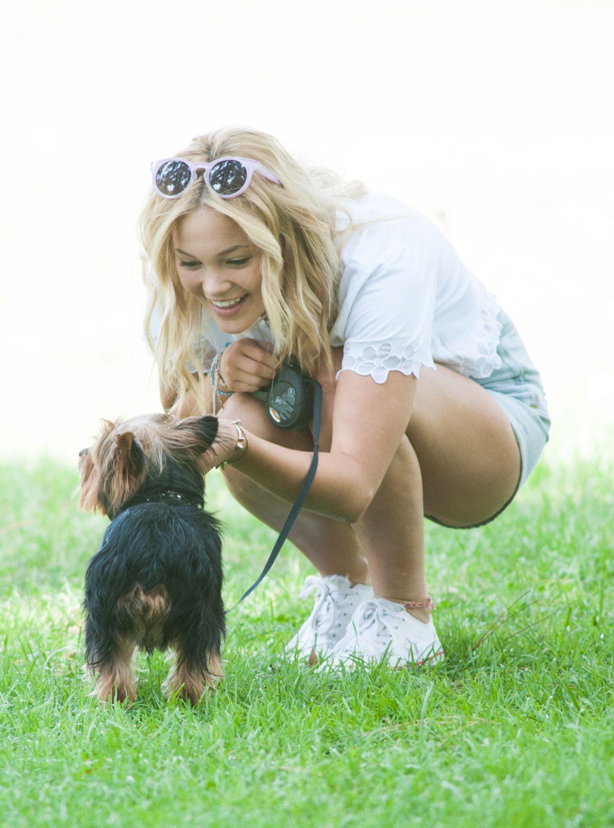 olivia holt walks her dog at a park in los amgeles   hawtcelebs