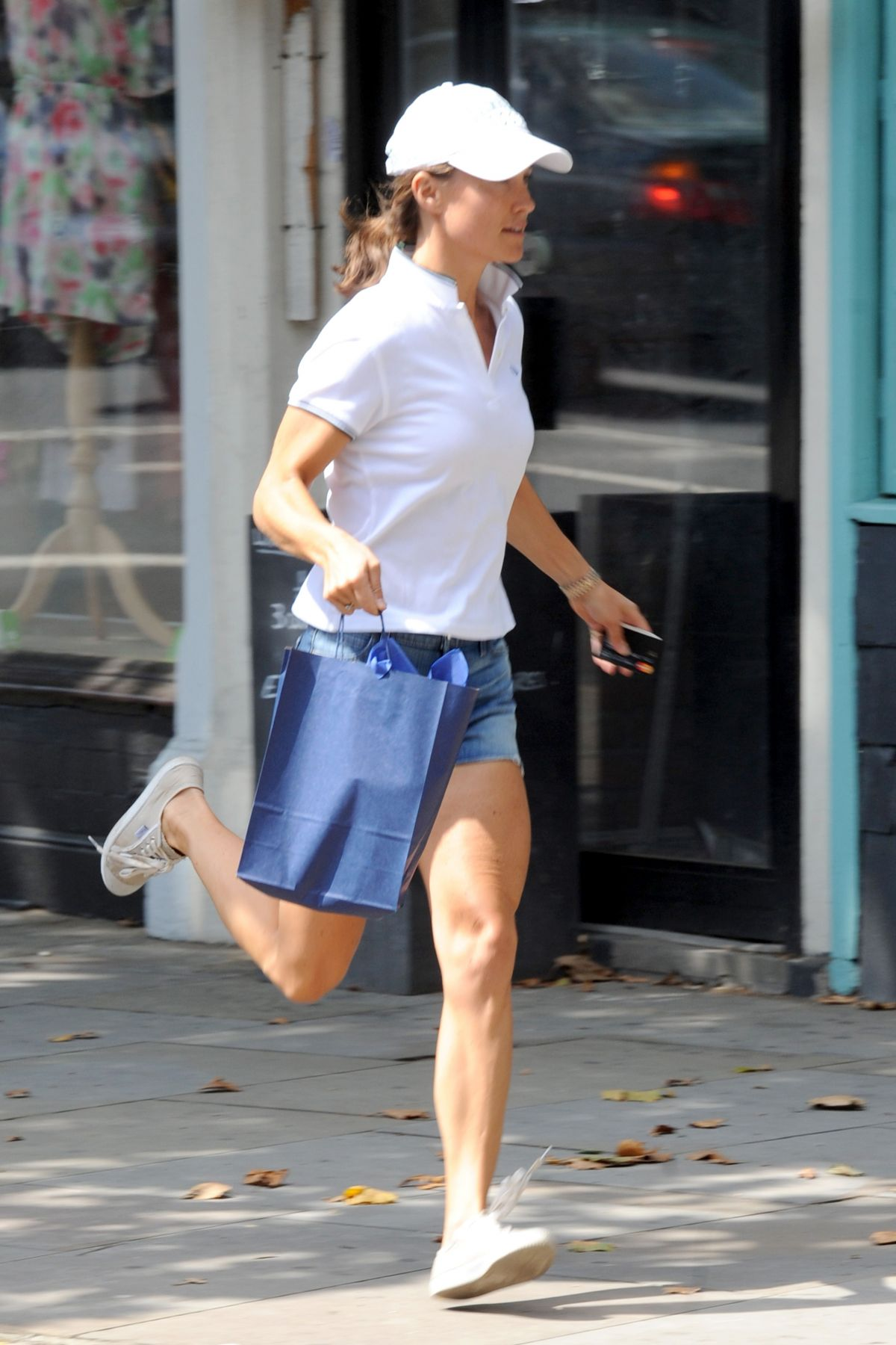 PIPPA MIDDLETON in Denim Shorts Running Out at Kings Road in London