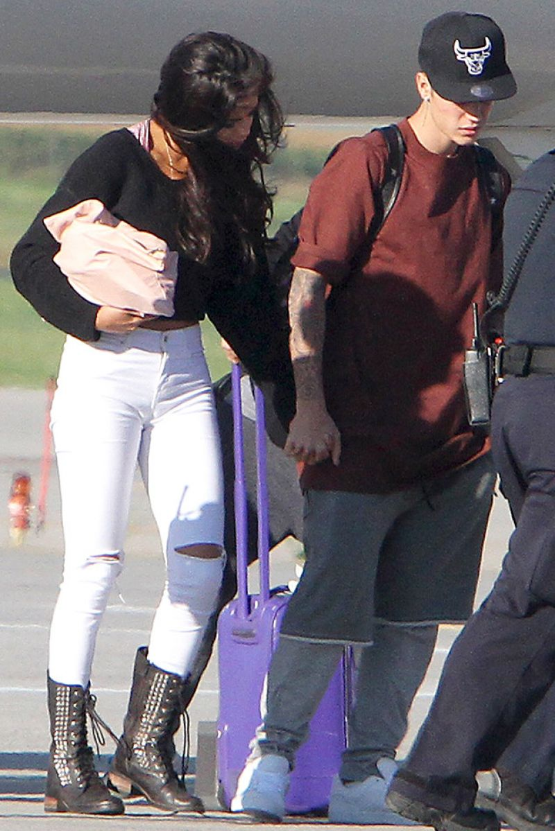 SELENA GOMEZ and Justin Bieber at Airport in Toronto