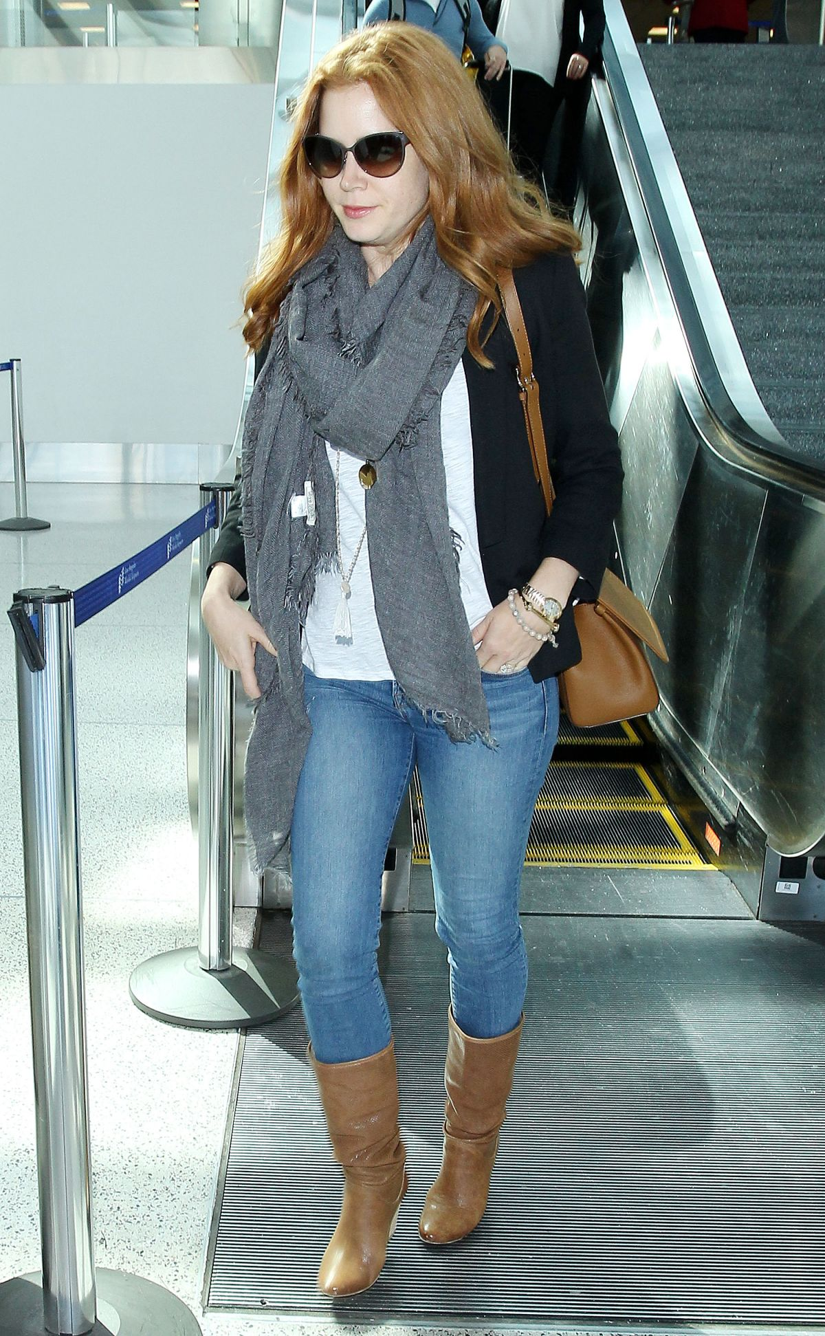 AMY ADAMS in Jeans Arrives at LAX Airport in Los Angeles