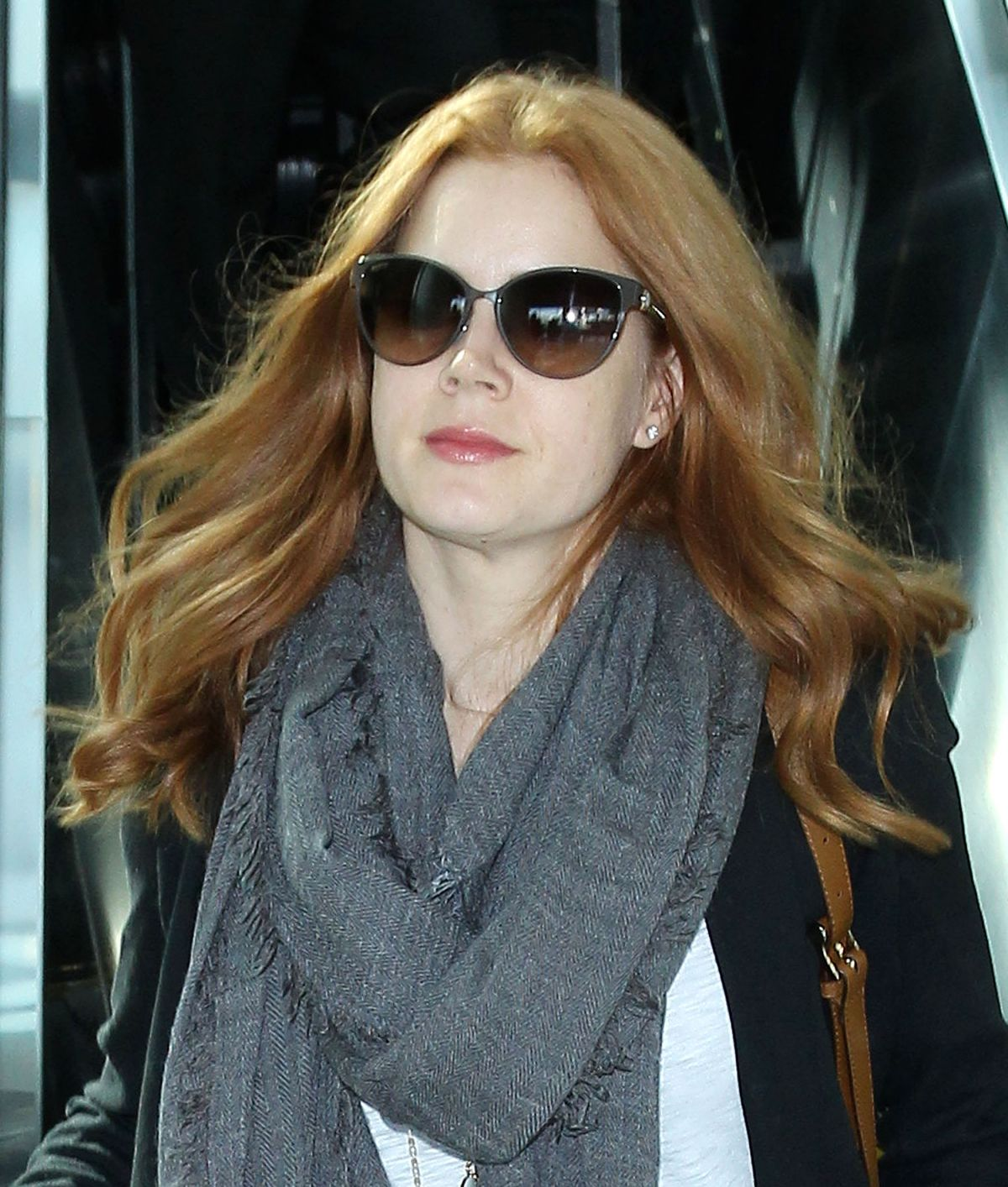 Amy Adams: AMY ADAMS In Jeans Arrives At LAX Airport In Los Angeles