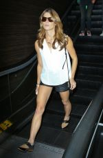 ASHLEY GREENE in Shorts at LAX Airport in Los Angeles