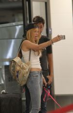 BELLA THORNE in Jeans Arrives at LAX Airport