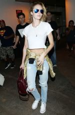 CANDICE SWANEPOEL in Ripped Jeans at LAX Airport