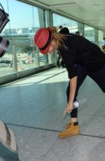 CARA DELEVINGNE at Heathrow Airport in London 0209
