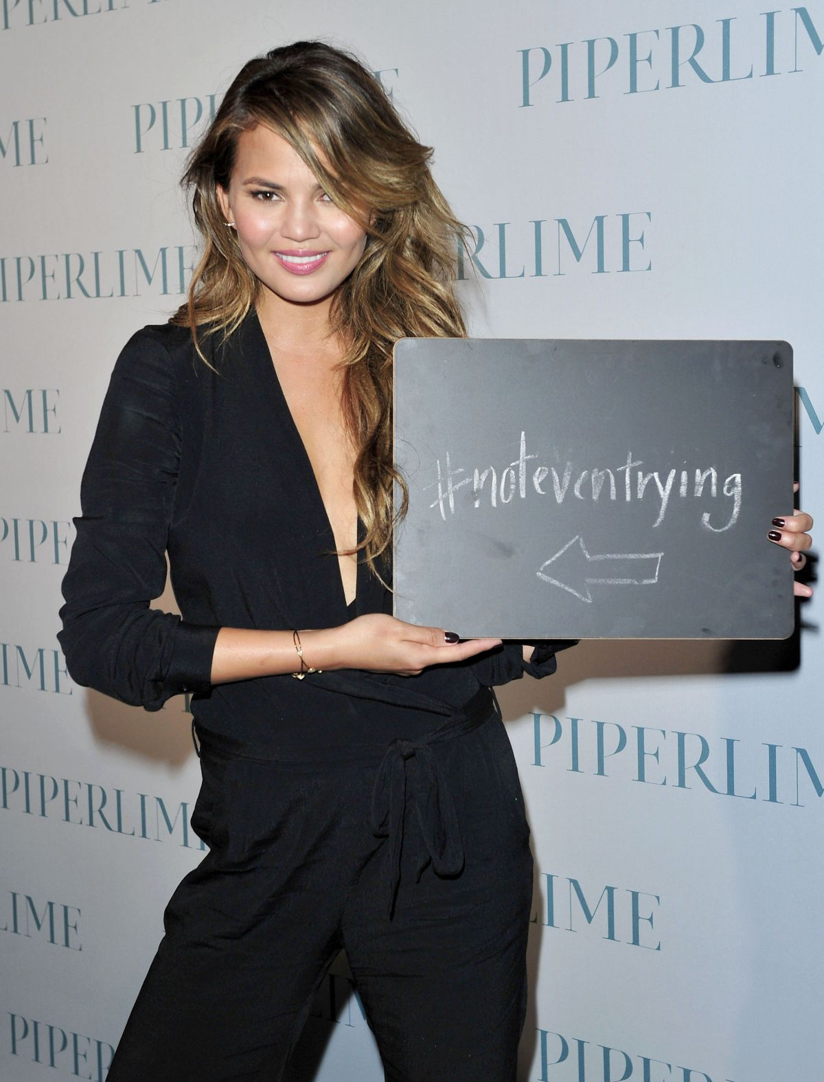 CHRISSY TEIGEN at New Piperlime Collection Launch in Los Angeles