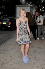 DAKOTA FANNING Arrives at a Fashion Show in New York