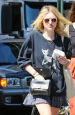 DAKOTA FANNING in Skirt Out and About in New York 1509