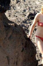 DAKOTA JOHNSON in Bikini at a Beach in Sicily