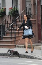FAMKE JANSSEN Walks Her Dog in New York
