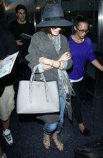 LILY COLLINS ar Los Angeles International Airport 2309