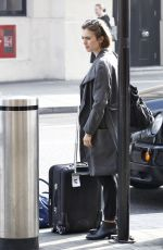 LILY COLLINS at A Railway Station in London