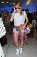 MARGOT ROBBIE in Denim Shorts Arrives at LAX