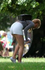 MARGOT ROBBIE in Shorts at a Park in London