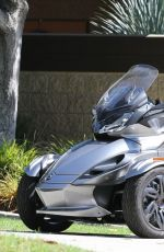 MILEY CYRUS Riding a Motorcycle Out in Beverly Hills