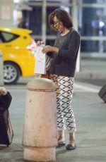 MILLA JOVOVICH Arrives at JFK Arport in New York