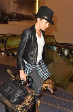 NIKKI REED and Her Dog at LAX Airport