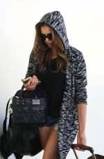 NINA DOBREV in Denim Shorts Arrives at LAX Aisport