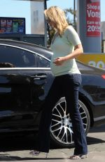 Pregnant ALI LARTER at a Gas Station in Los Angeles