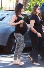 Pregnant MILA KUNIS in Tights Leaves Starbucks in Studio City