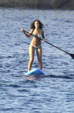 RIHANNA in Bikini Paddleboarding in Italy